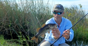 Florida Sportsman Editor Jeff Weakley canoeing to some skinny water Florida bass.