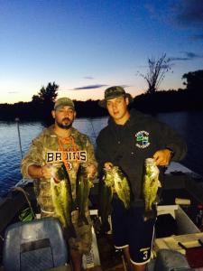 My cousins Joe and Chris Critelli hold up some Upstate New York bass.