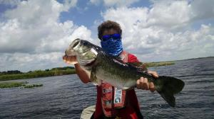Matt Yudor, 12, is putting a hurting on some Florida bass while staying sun-safe.