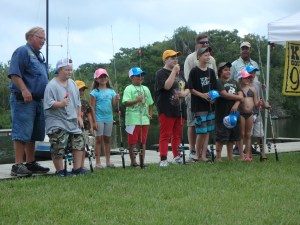 Young anglers show off some prizes at a Youth Fishing Tournament in Florida.
